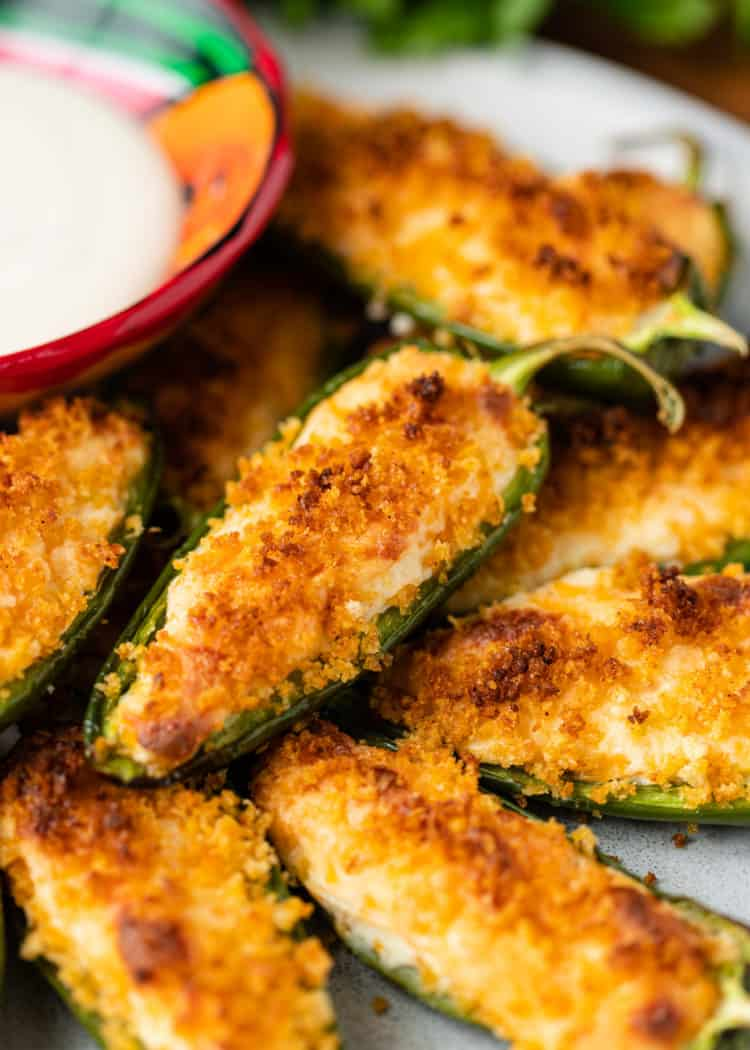 baked Jalapeño Poppers on plate with dip