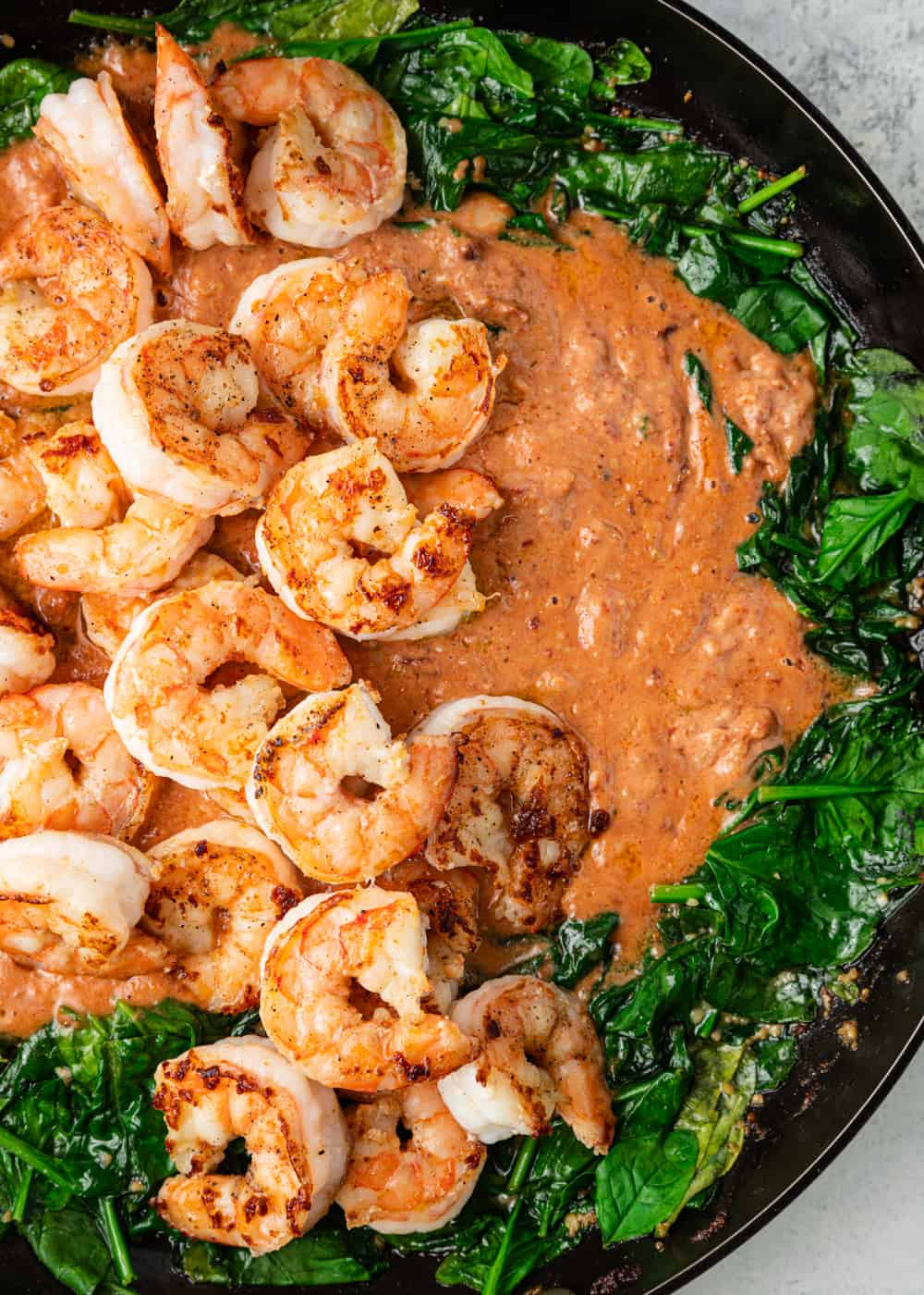 sauteed shrimp with tomato sauce and spinach