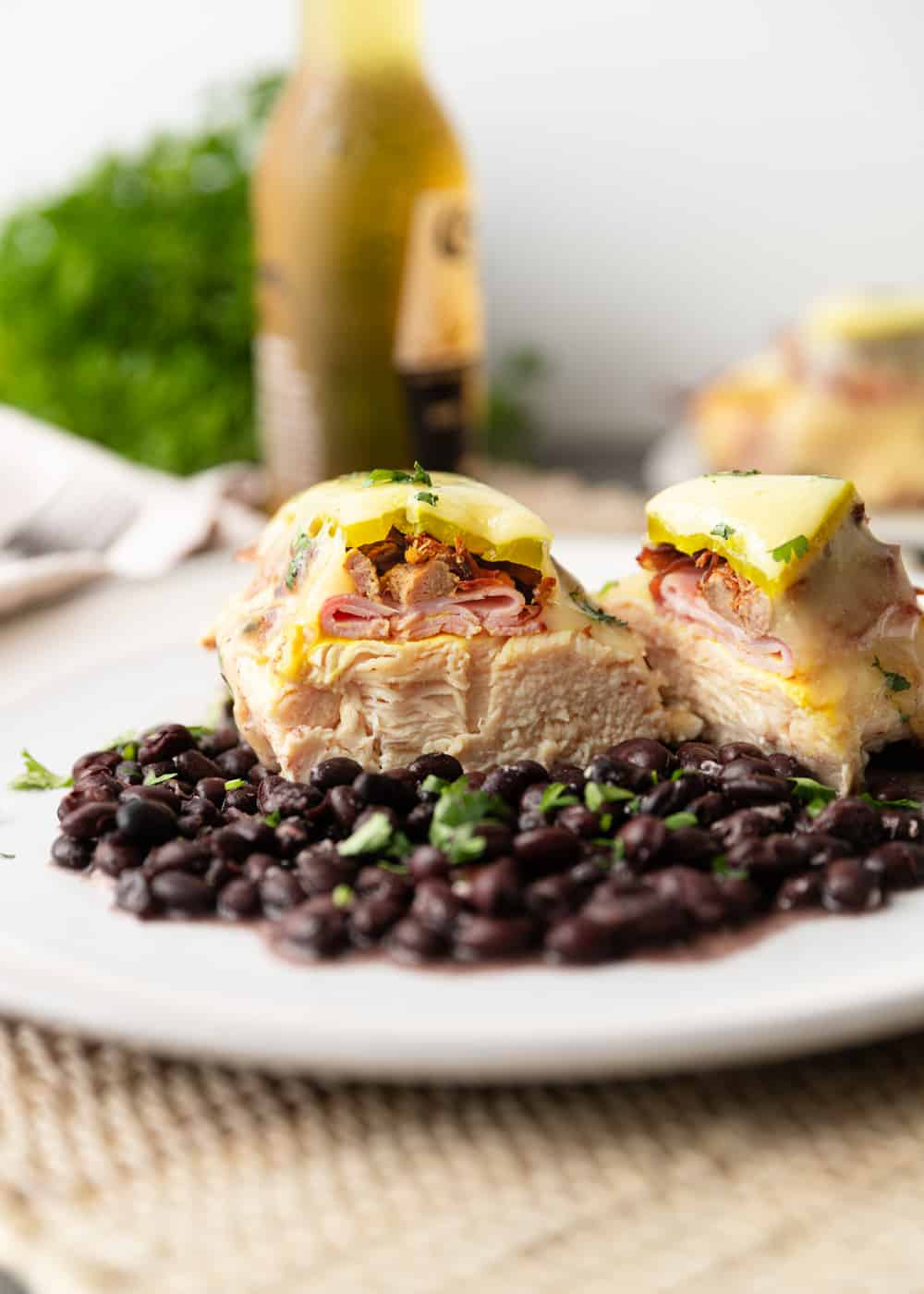 Baked Chicken Cubano on black beans