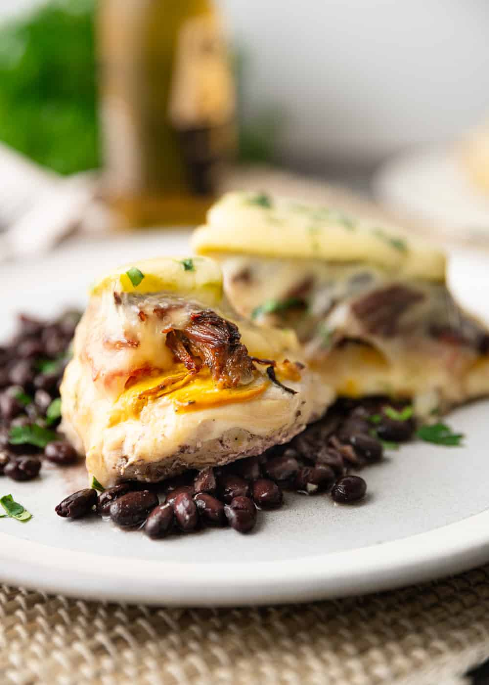 chicken sandwich with black beans on plate