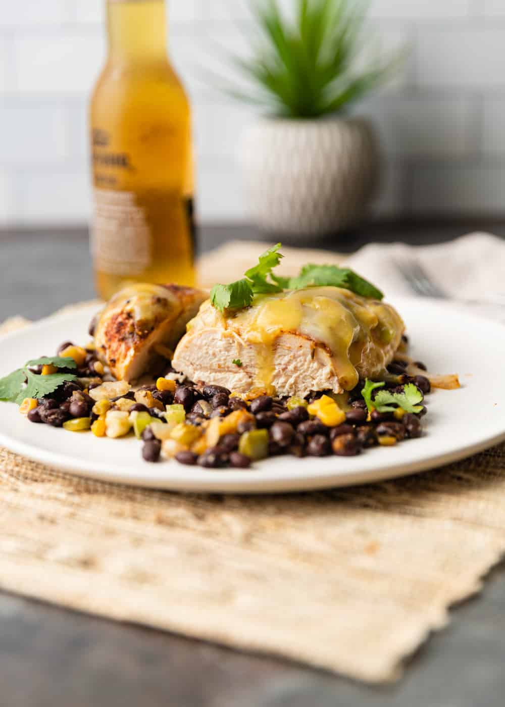 plated dinner of Santa Fe chicken (chicken breast covered with cheese, black beans and corn)
