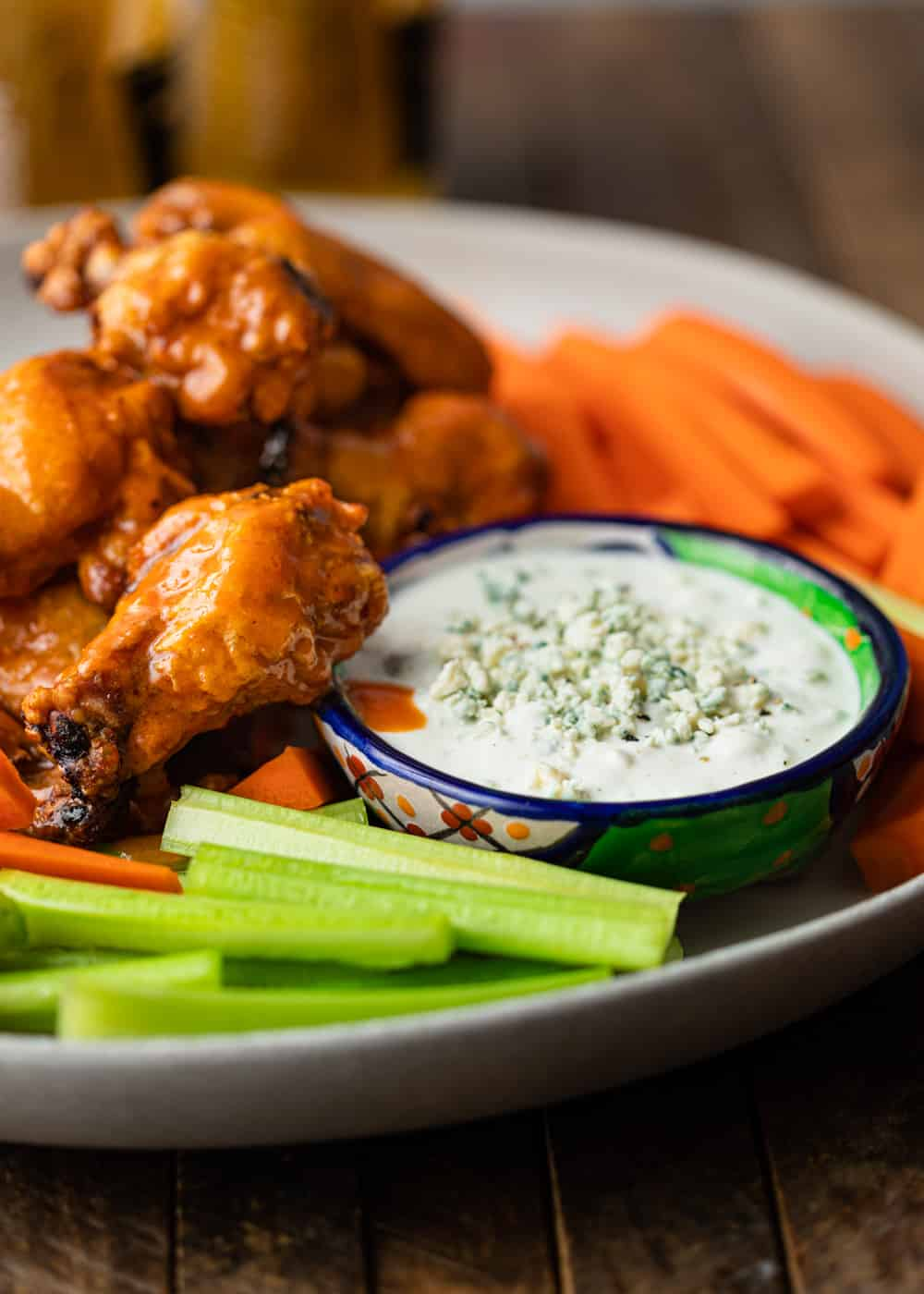 small bowl of blue cheese dip with wings