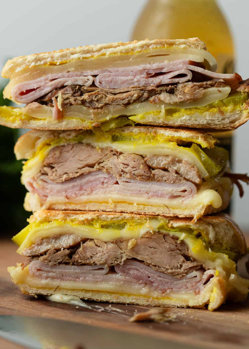 Stacks of Cuban Sandwiches on a cutting board.