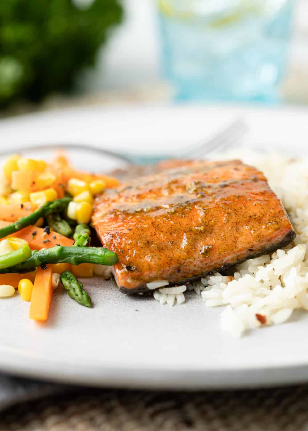 glazed salmon on plate with vegetables