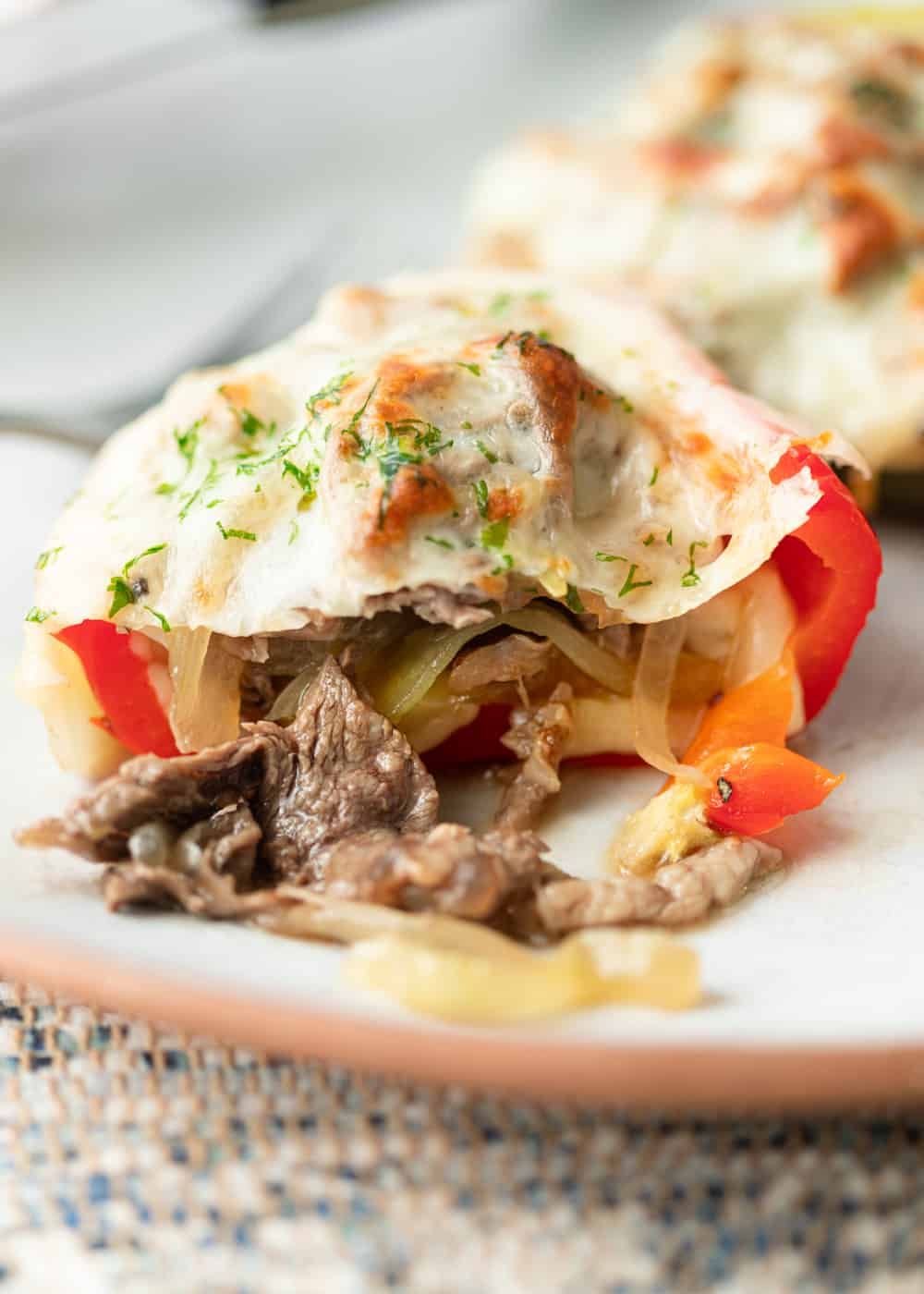 sliced pepper with melted cheese and steak filling