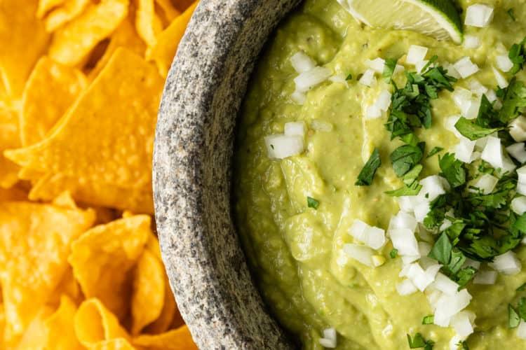 bowl of avocado salsa and tortilla chips