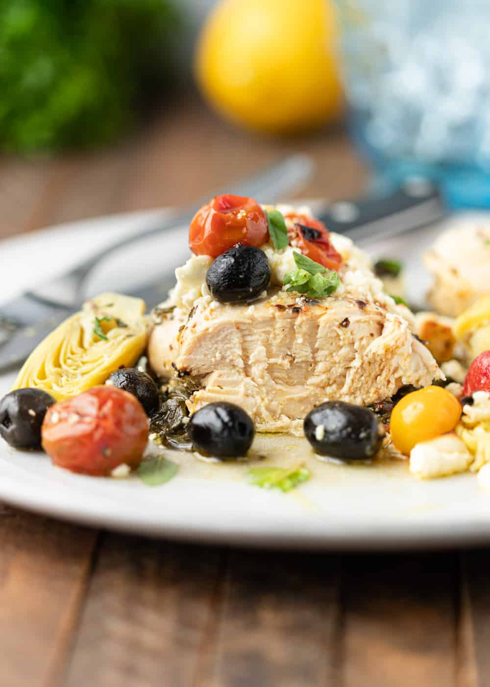 sliced chicken breast with olives, tomatoes and artichoke hearts