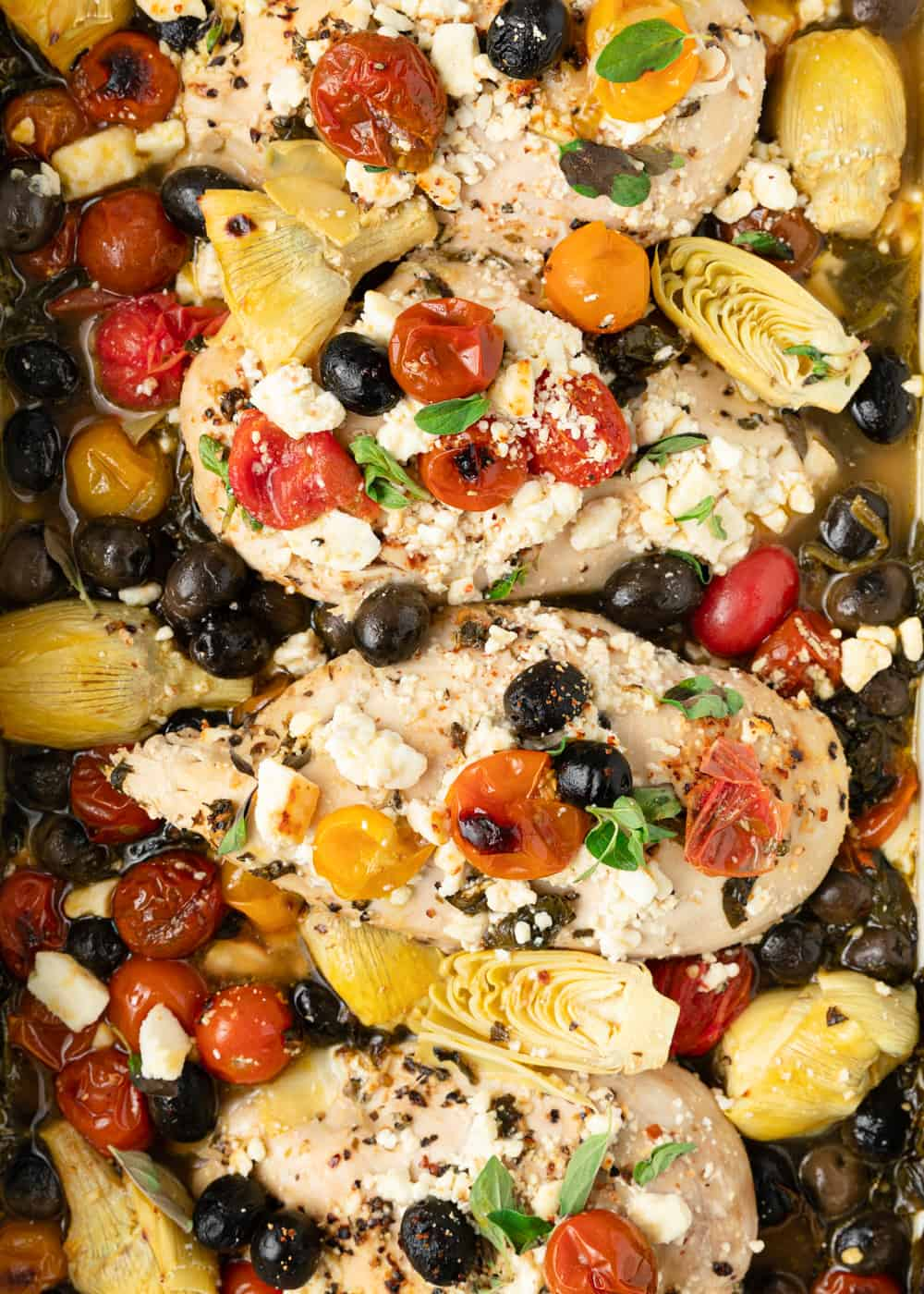 Mediterranean chicken breasts topped with black olives, tomatoes, artichoke hearts and feta cheese