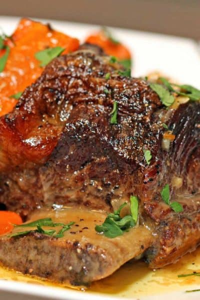A close up of a plate of Beef short Ribs