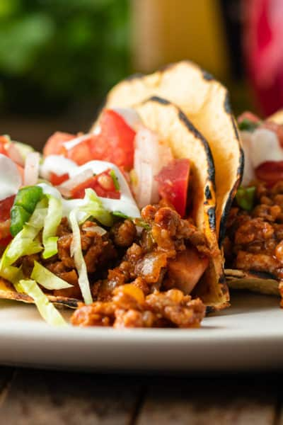 plate of Mexican tacos with ground pork