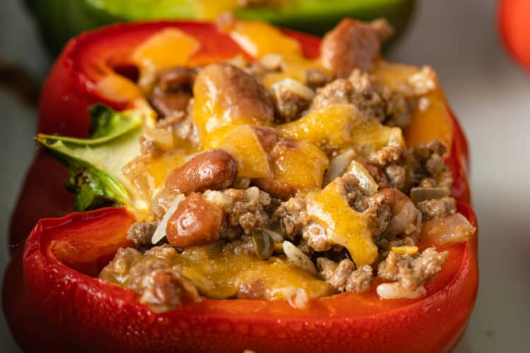 close up image of Mexican stuffed peppers (green and red)