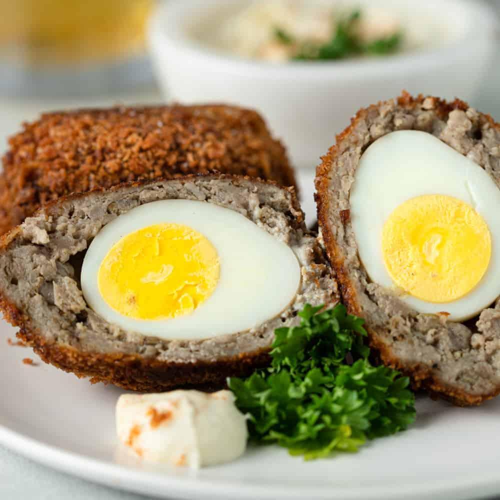Scotch egg, cut in half, revealing the inside