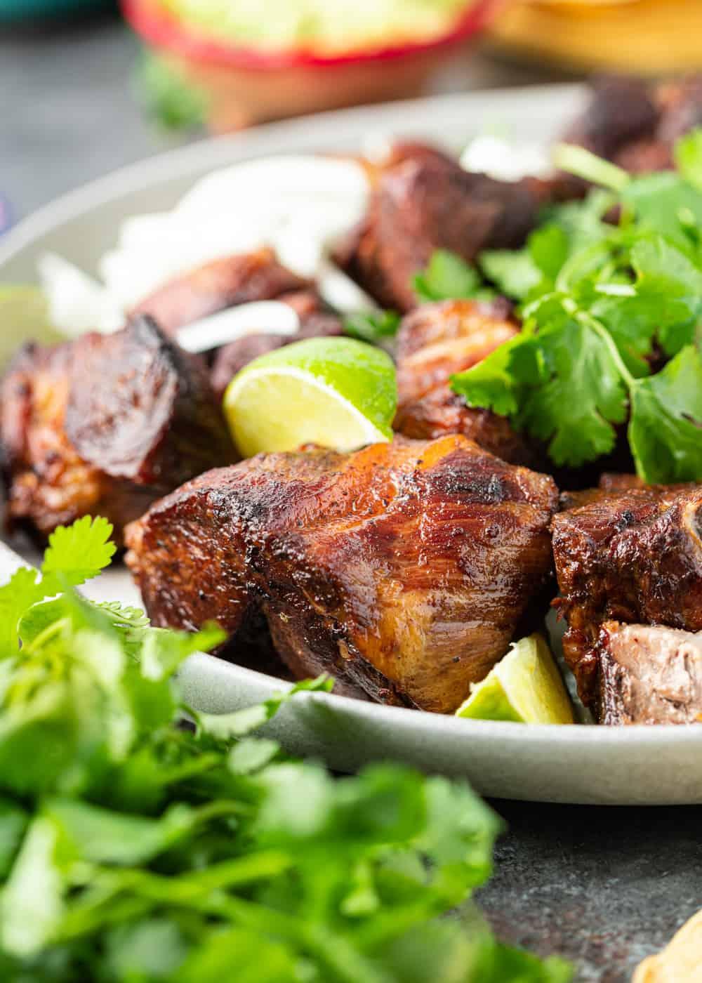 chunks of pork carnitas with lime and cilantro