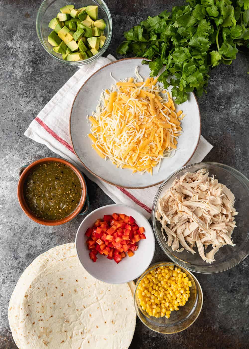 bowls of ingredients to make chicken quesadilla recipe