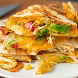 stack of crispy chicken quesadillas on a plate