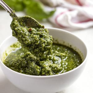 A bowl of fresh Pesto with spoon