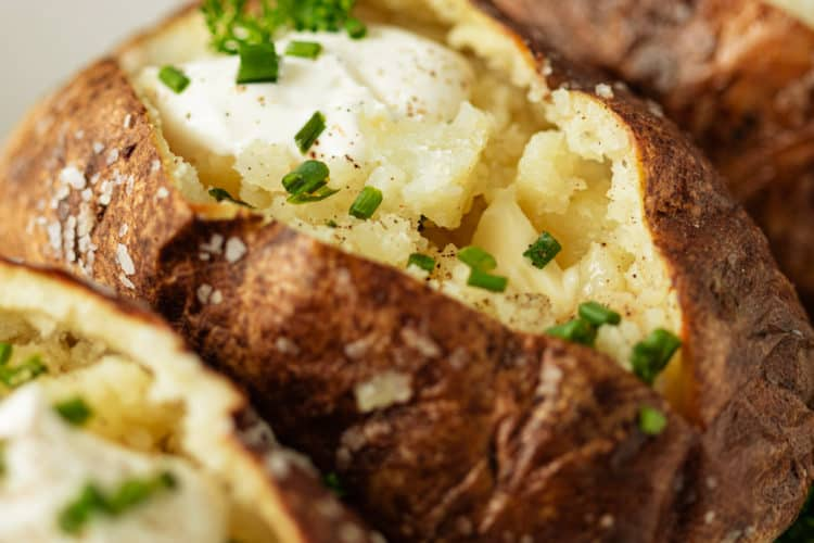 the perfect baked potatoes, topped with sour cream and chives