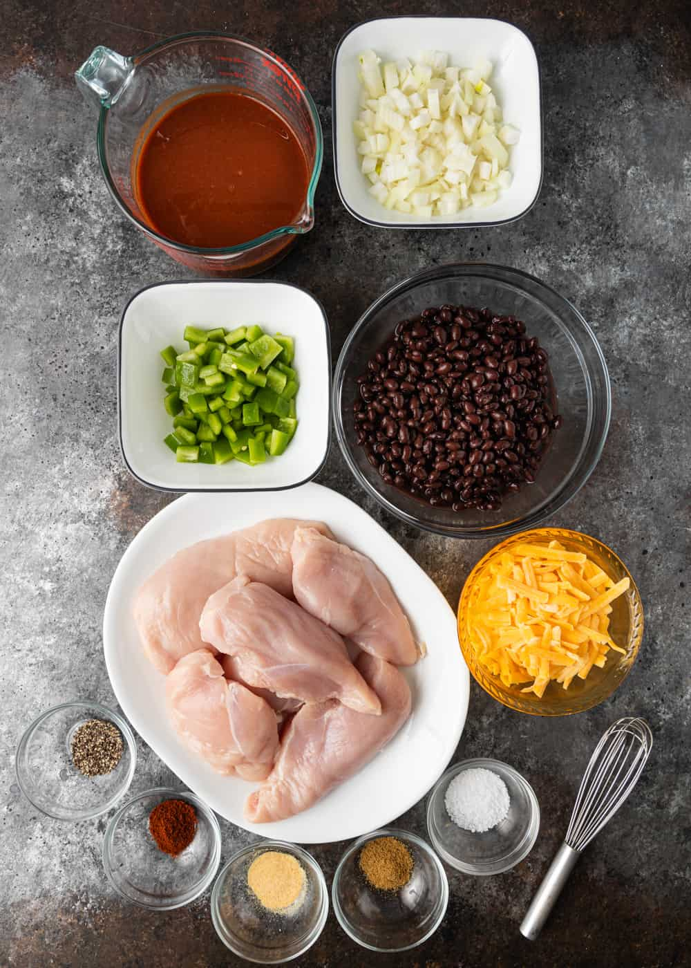 boneless skinless chicken breasts and other ingredients in bowls to make Mexican baked chicken