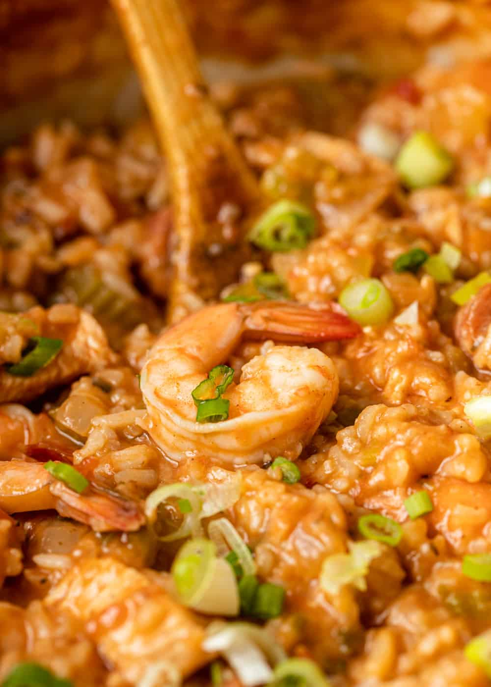 wooden spoon stirring cajun jambalaya