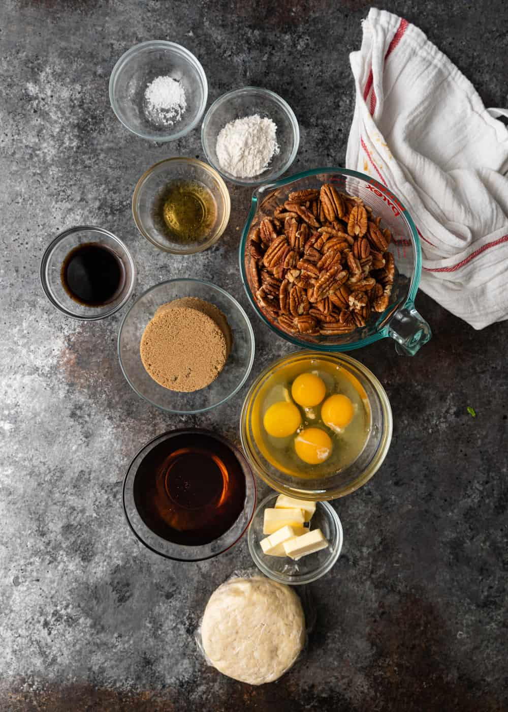 overhead photo: ingredients in glass prep cups to make southern pecan pie recipe