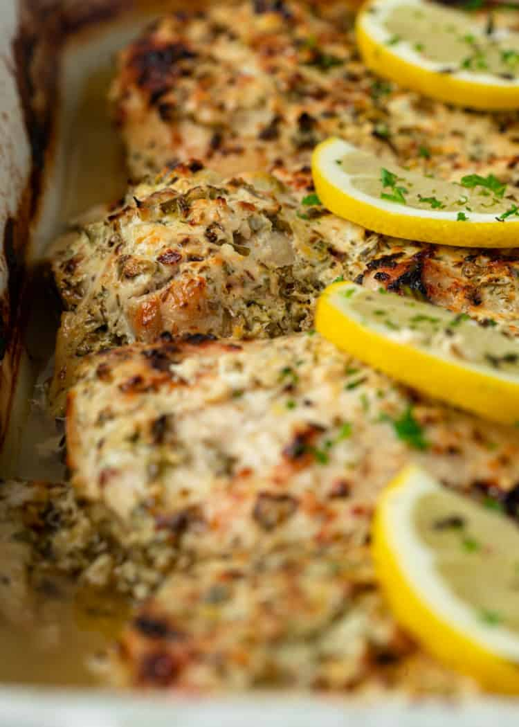 baked Greek Chicken thighs with rosemary and lemon slices