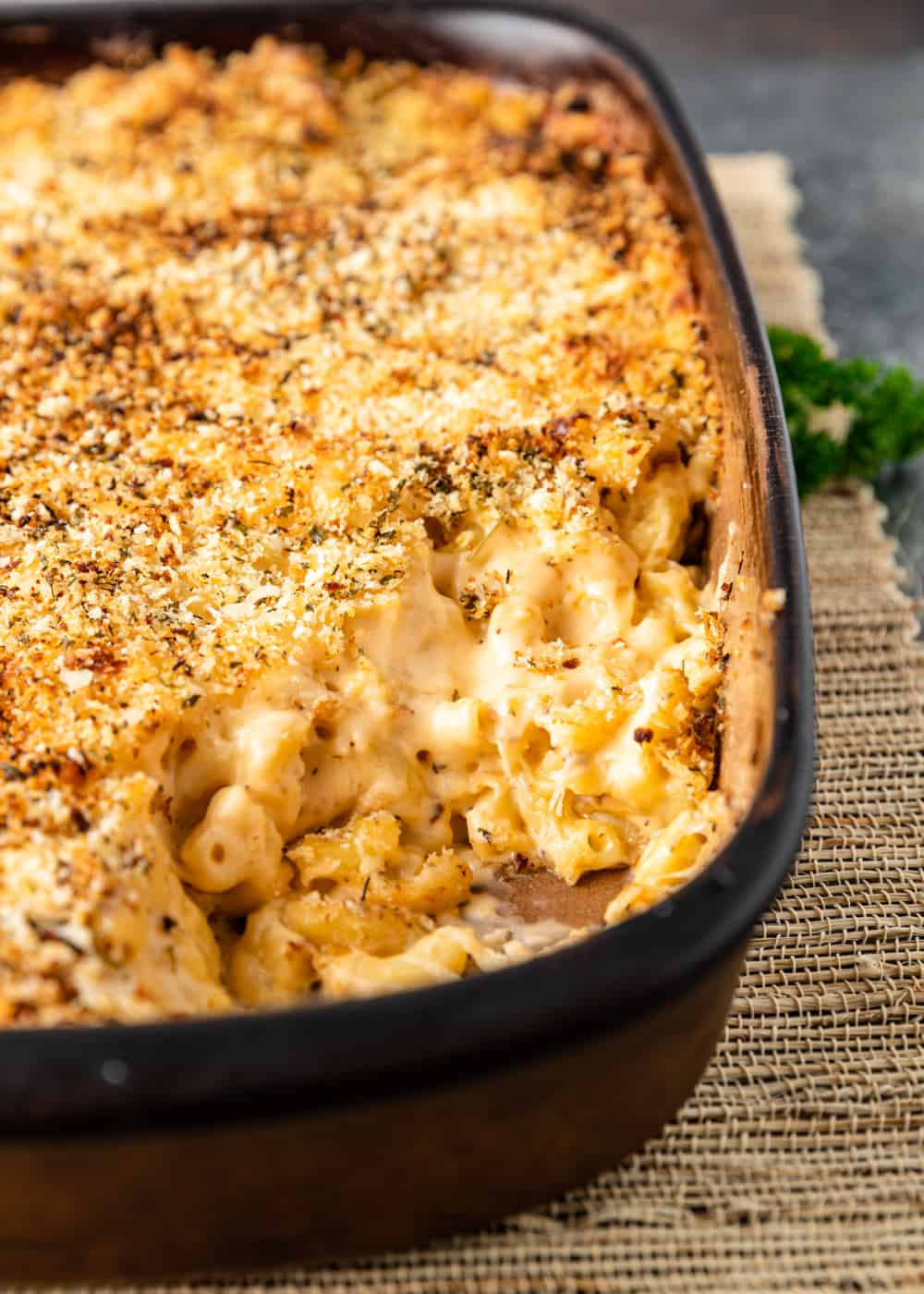 smoked macaroni and cheese in casserole dish with serving removed from one corner