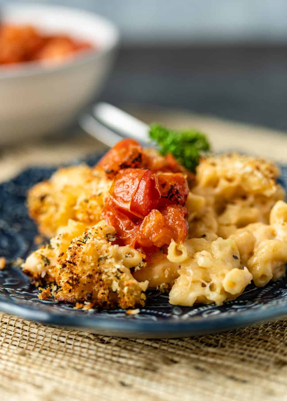 creamy cheddar cheese and macaroni dinner topped with toasted breadcrumbs and fire roasted tomatoes