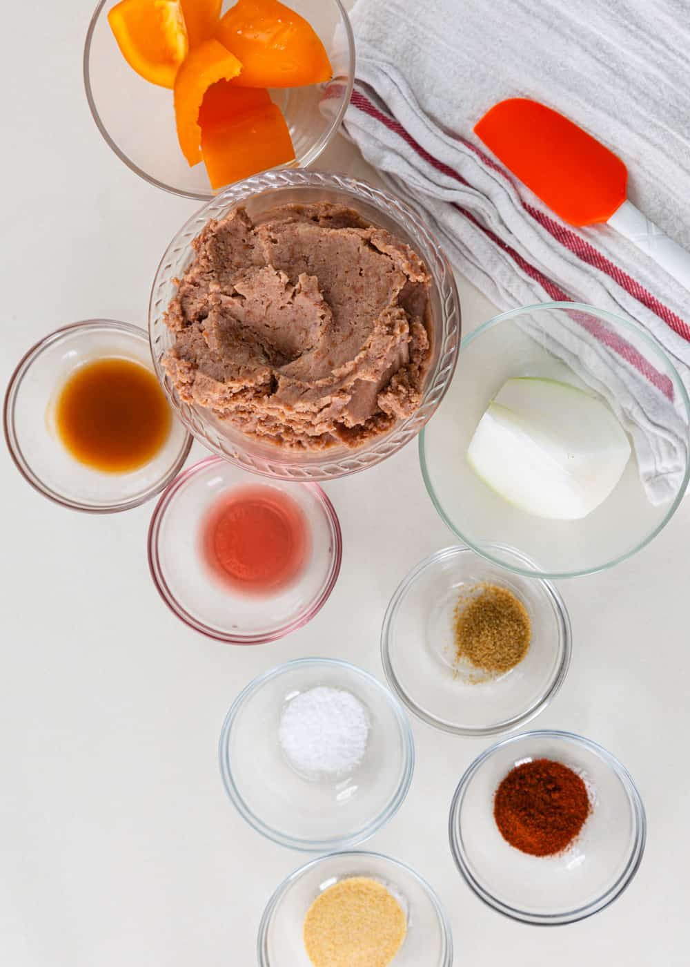 overhead image: ingredients in small glass prep bowls to make refried bean dip recipe