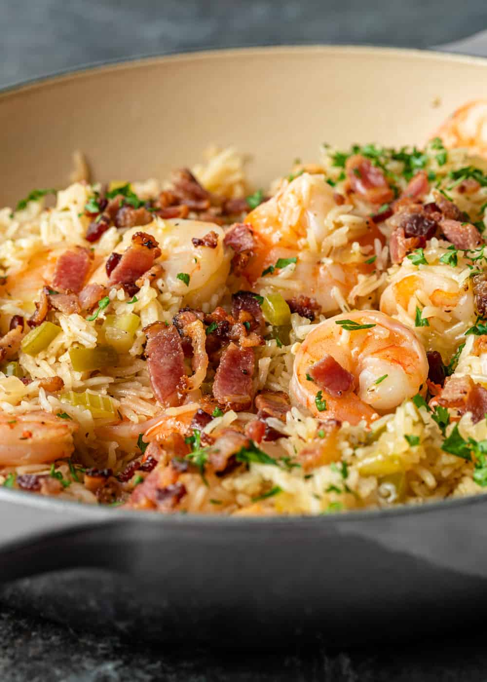 close up of cajun shrimp and cooked bacon in rice