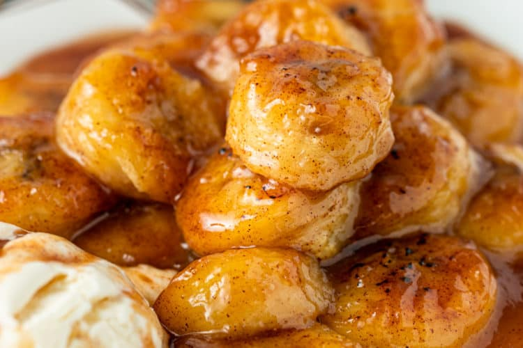 bowl of warm cinnamon honey fried bananas with scoop of vanilla ice cream