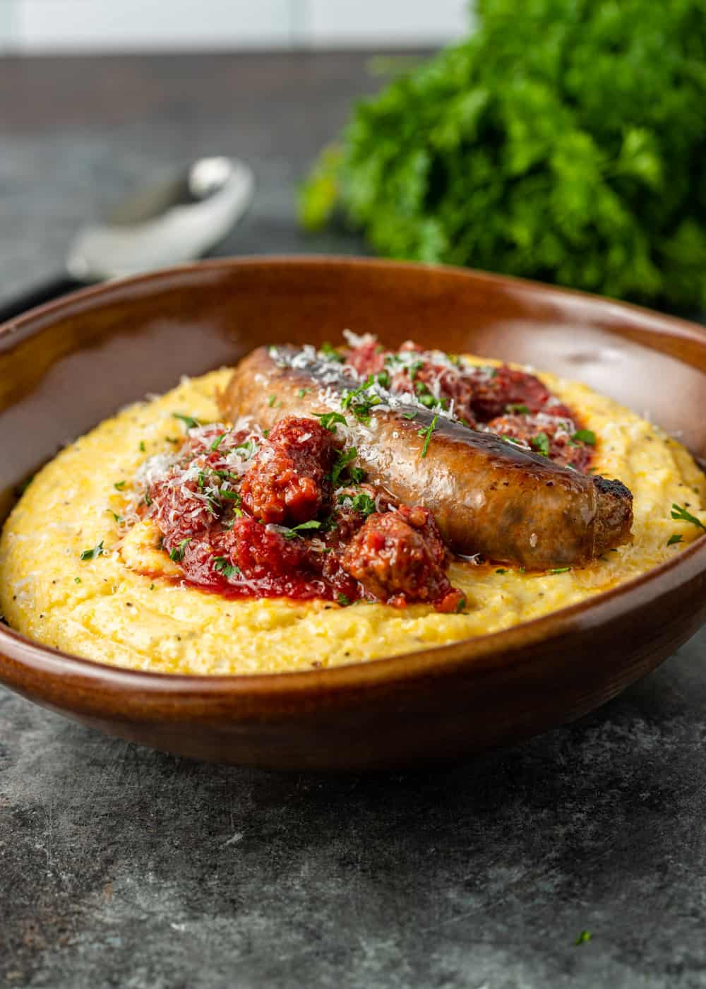 side view of Italian dinner with sausage ragu over cheesy polenta