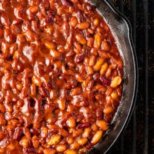 A close up smoked beans in metal pan