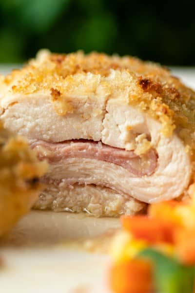 side view shows inside of baked chicken cordon bleu