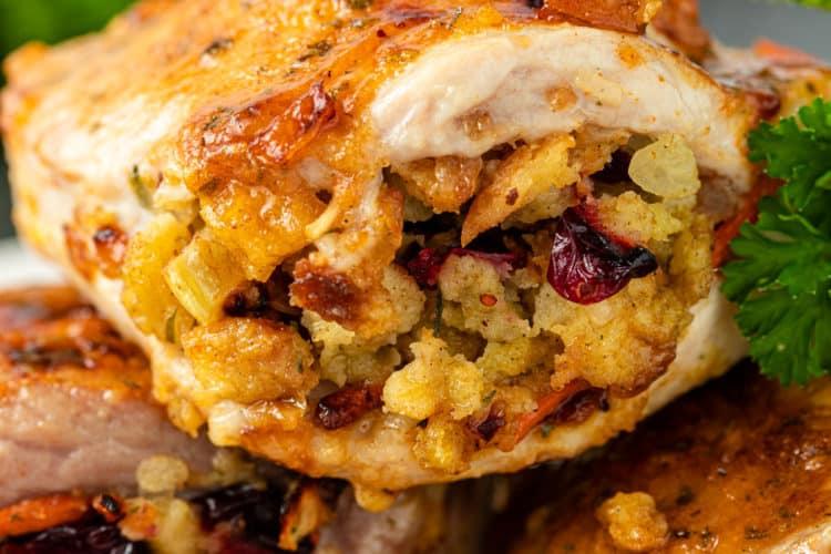 closeup of cranberry stuffing in bake dpork chop