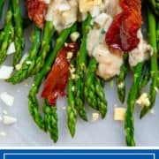 crispy prosciutto crumbled on asparagus with chopped egg and sauce
