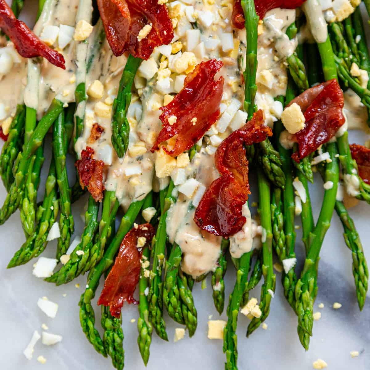 blanched asparagus with tarragon sauce, prosciutto and chopped egg and tarragon sauce