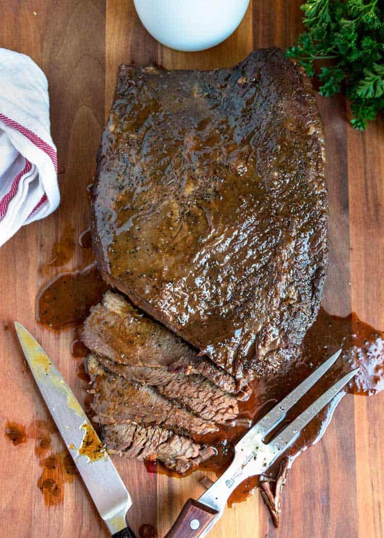 overhead photo of braised beef brisket on cutting board