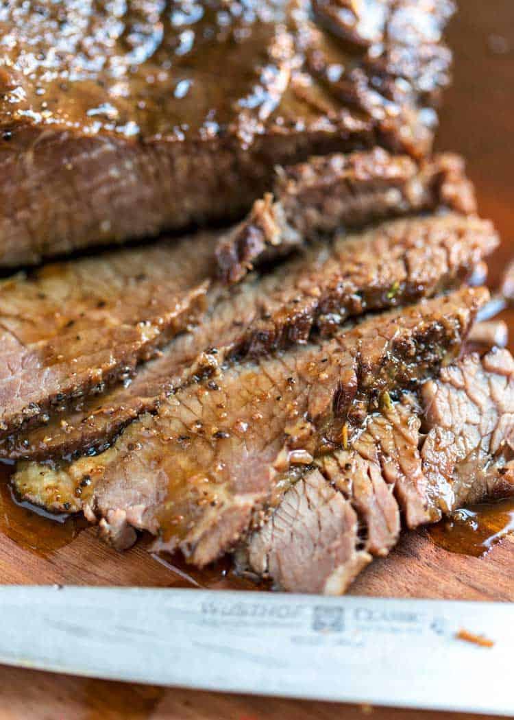 juicy slices of braised beef brisket with sauce