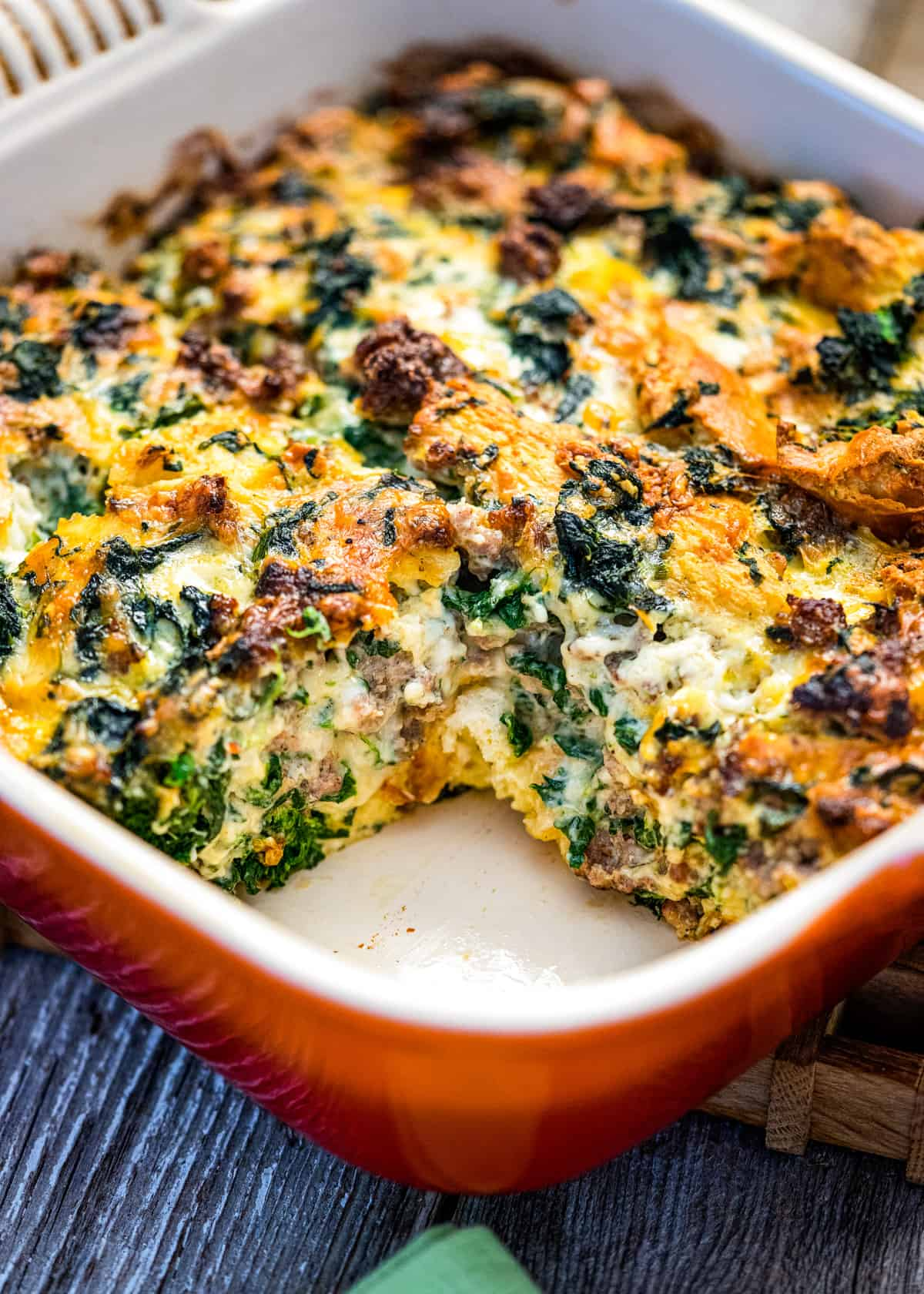 cheesy baked eggs casserole with Italian sausage and spinach