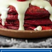 titled photo for Pinterest shows stack of red velvet heart shaped pancakes with fresh raspberries on top