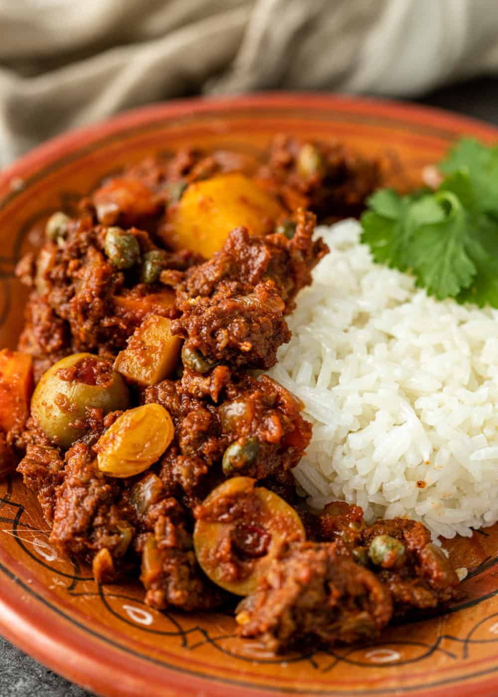 beef picadillo and cilantro lime rice on plate
