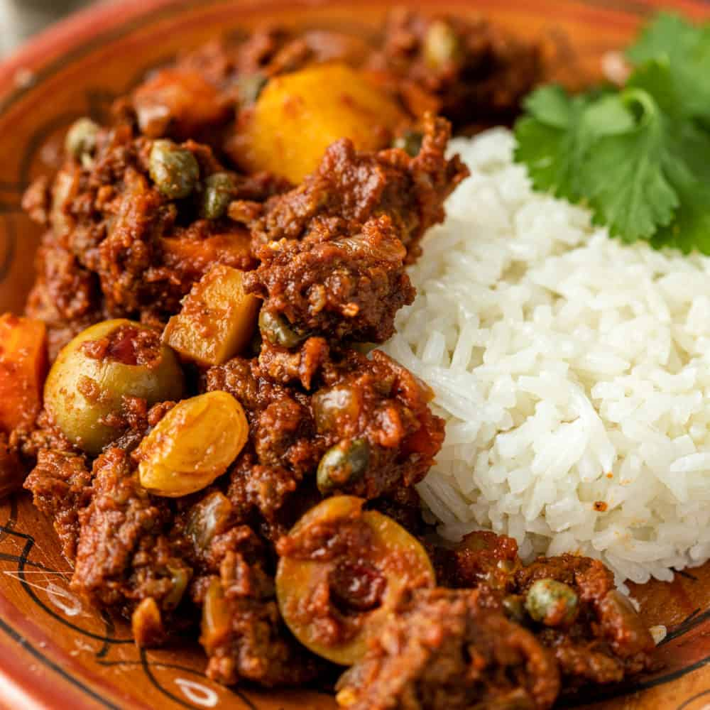 Cuban beef picadillo on a plate with rice