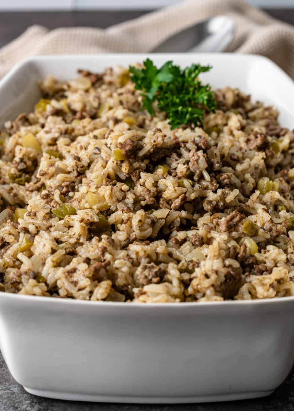white rectangular casserole dish filled with Cajun dirty rice