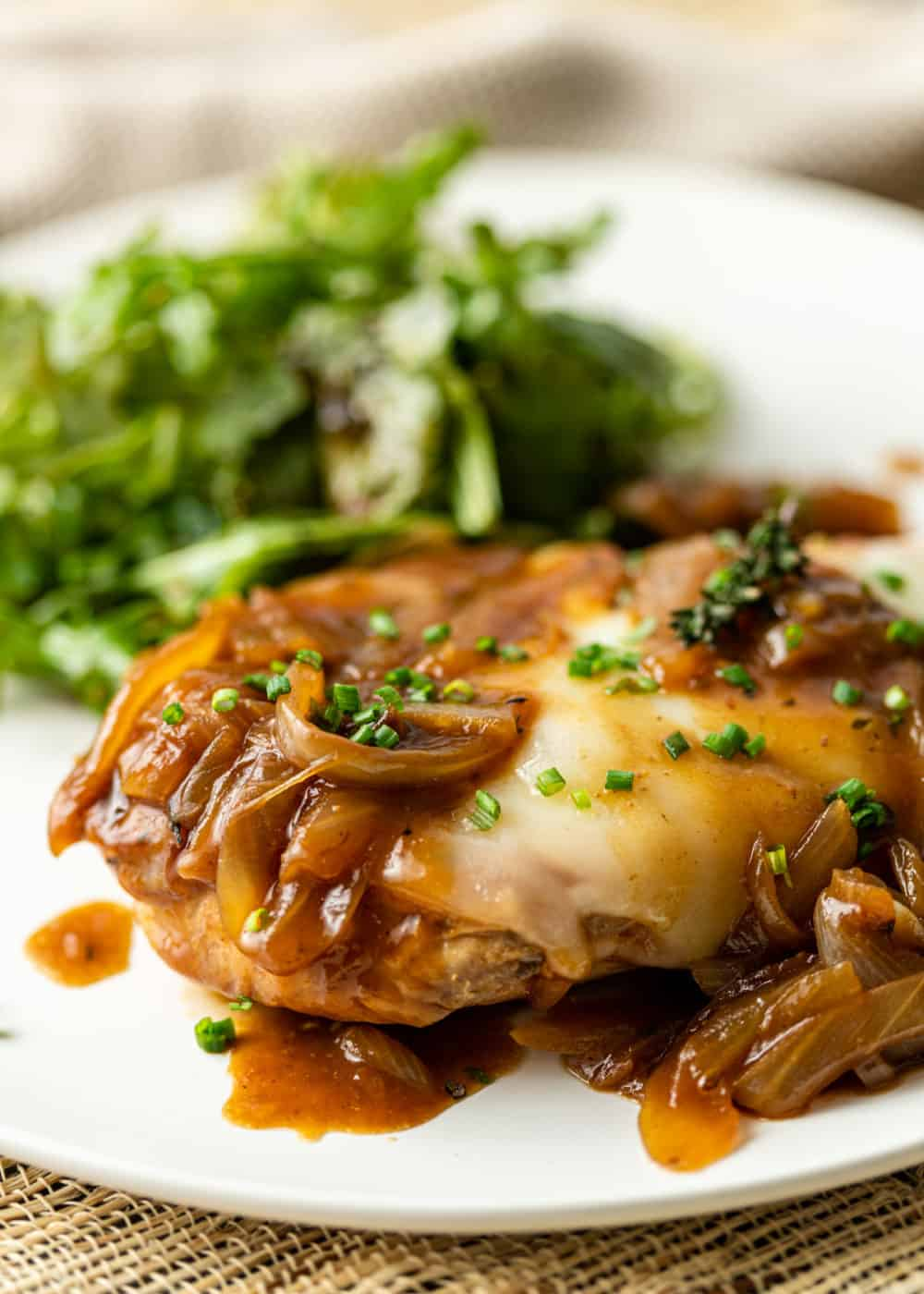 close up image of cooked chicken and onions