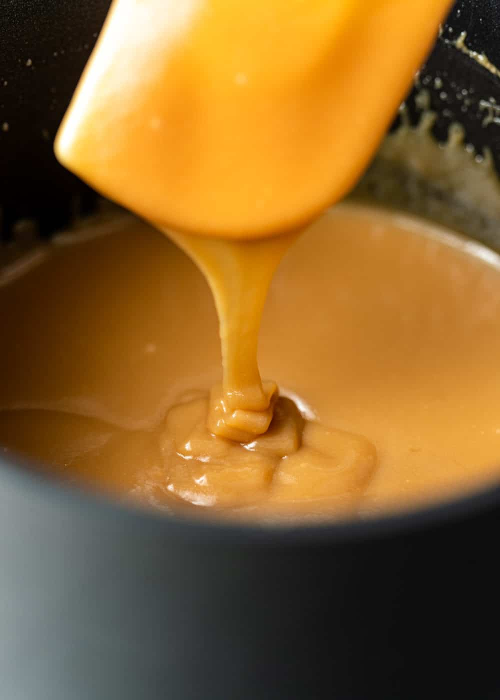 sweetened condensed milk caramel in a pan with a spatula
