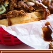 root beer pulled pork sandwich dripping with bbq sauce
