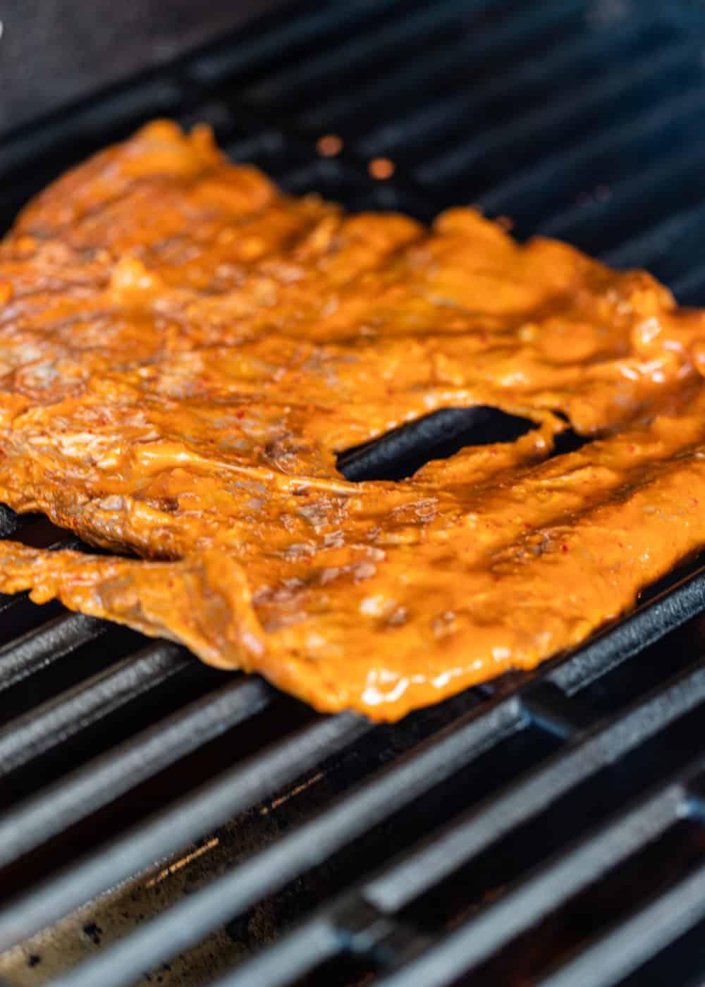 marinated steak on grill
