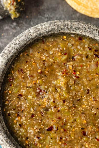 overhead: spicy Mexican sauce in gray serving bowl