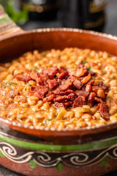 crispy bacon pieces garnish bowl of borracho beans