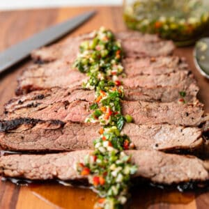 close up of cilantro chimichurri on grilled steak